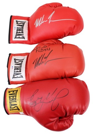 Floyd Mayweather Jr. & Two Mike Tyson Autographed Single Boxing Gloves (3)(JSA • PSA/DNA)